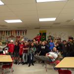 On a class visit, coach Nancy poses goofy with the students and teacher at Madison Middle School